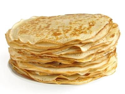 pancakes pile against white background