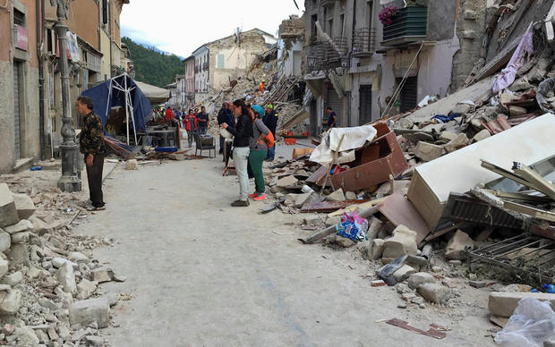 Rescuers work following an earthquake that hit Amatrice